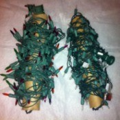 Two rolls of Christmas lights on paper tubes.