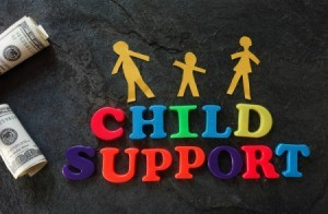 Photo of letters spelling out child support.