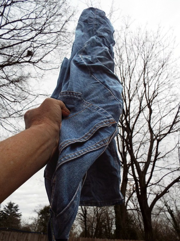 Jeans frozen after being hung outside while wet.