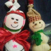 two finished snowmen ornaments