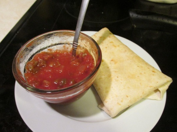 folded melt on plate with salsa