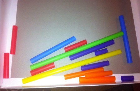 Easy Marble Maze - pieces of brightly colored plastic straws