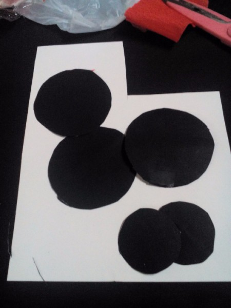 black paper circles for the eyes and buttons