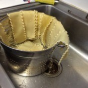 A pot of lasagne noodles, cooked and drained.