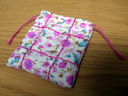 Fabric and Button Tic-Tac-Toe Game - tie ends of the embroidery floss on the front and back of bag to each other