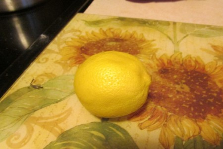 Using Lemon as an Odor Remover - whole lemon on flowered cutting mat