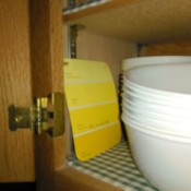 A yellow paint sample being stored in the kitchen.