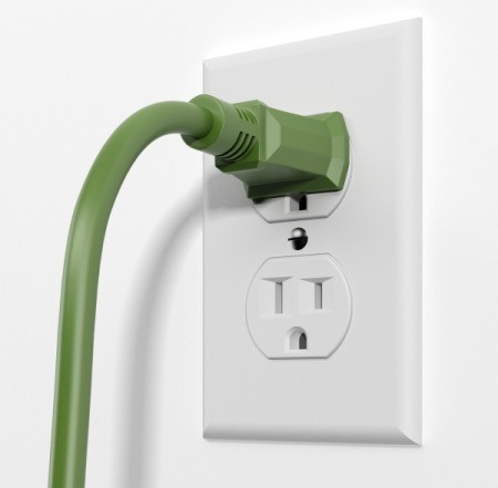 Electrical outlet with a green cord plugged in.