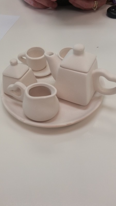 Unpainted pottery tea set, ready for glazing.