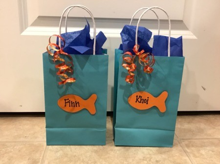 Goldfish Party Treat Bags - filled bags topped with dark blue tissue paper