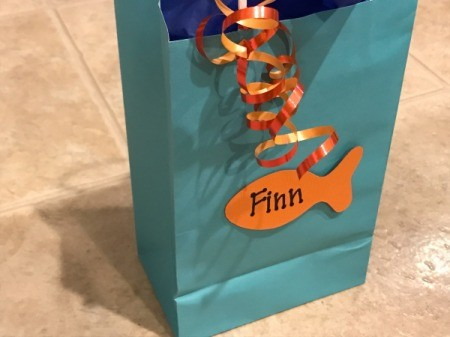 Goldfish Party Treat Bags - bag with fish attached, curly ribbon on handle