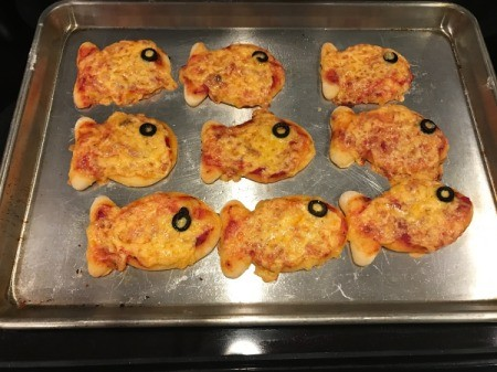 Goldfish Shaped Mini Pizzas - baked pizzas on the pan cooling