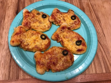 Goldfish Shaped Mini Pizzas - cooked fish pizzas on blue plate