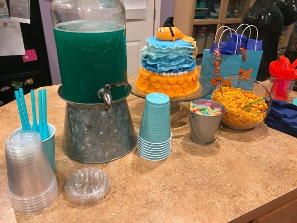 Goldfish Themed Party Snacks - island with cake, punch, snacks, and cups