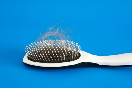 A brush full of hair from hair loss.