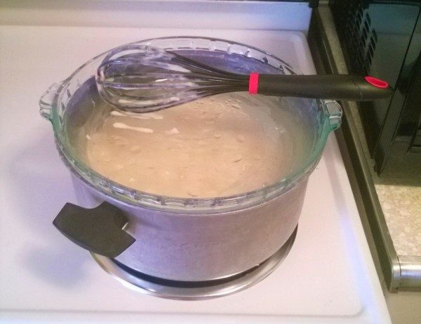 A pie plate being used as a makeshift pot lid.