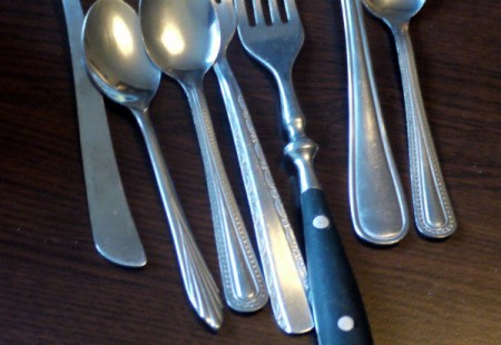 A collection of mismatched silverware.