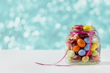 Baby Food Jar filled with colorful egg candy.