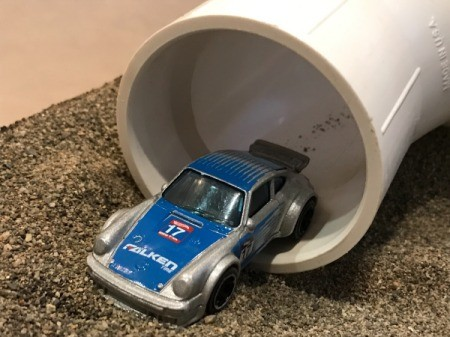 Indoor Sandbox - car coming out of the tunnel