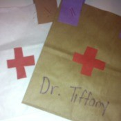 Doctor's Bag Craft - cut out red crosses for bags and glue in place