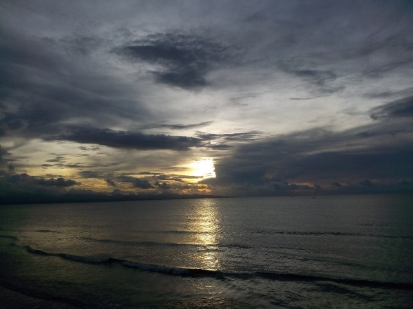 A cloudy sunset over the ocean in the Philippines