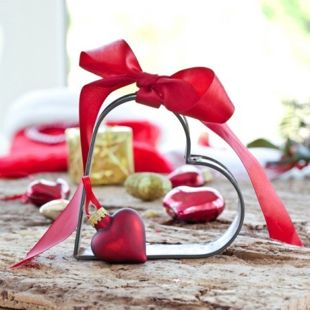 Heart cookie cutter with red bow.