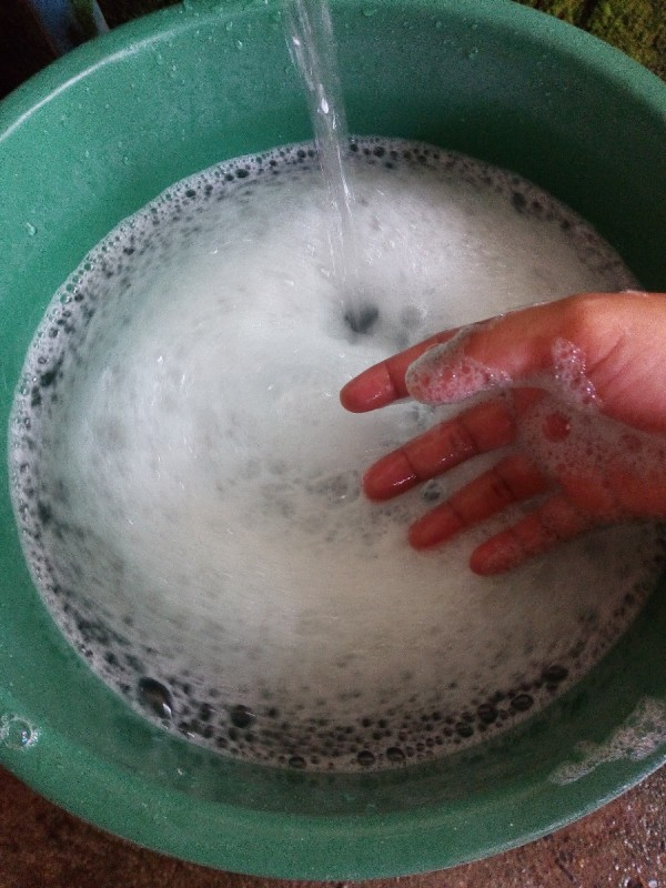 A bucket of soapy water.