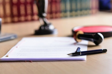 Power of Attorney documents on a desk.