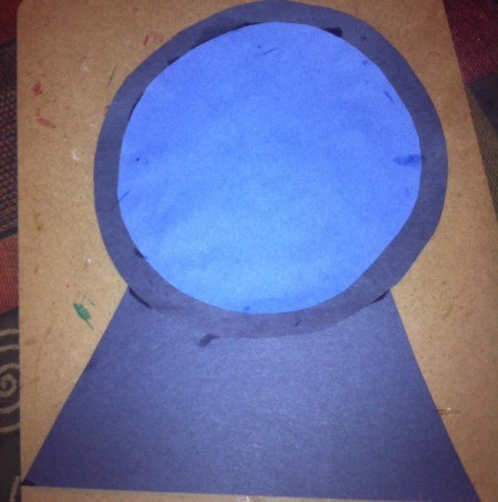 Fingerprint Snow Globe - cut out black trapezoid and blue and black circles, then glue