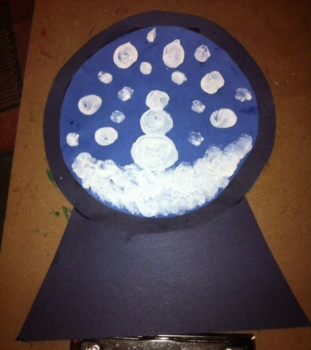 Fingerprint Snow Globe - with index finger and white paint make snow at base, then snowman and falling snow