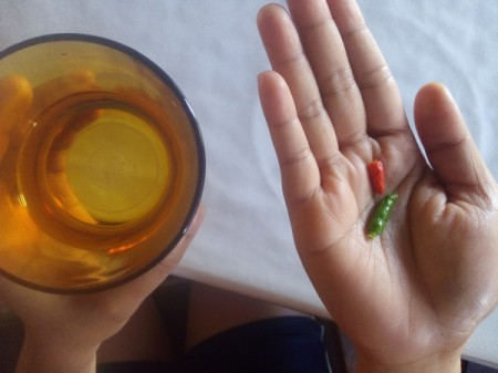 A couple of small chillies and a glass of water.