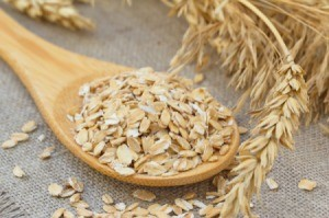 A spoon full of rolled oats or oatmeal.