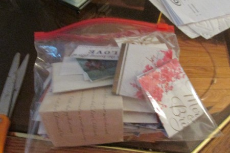 A bag full of homemade gift tags from Christmas cards.