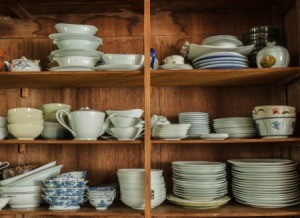 A cabinet with several types of dishes.