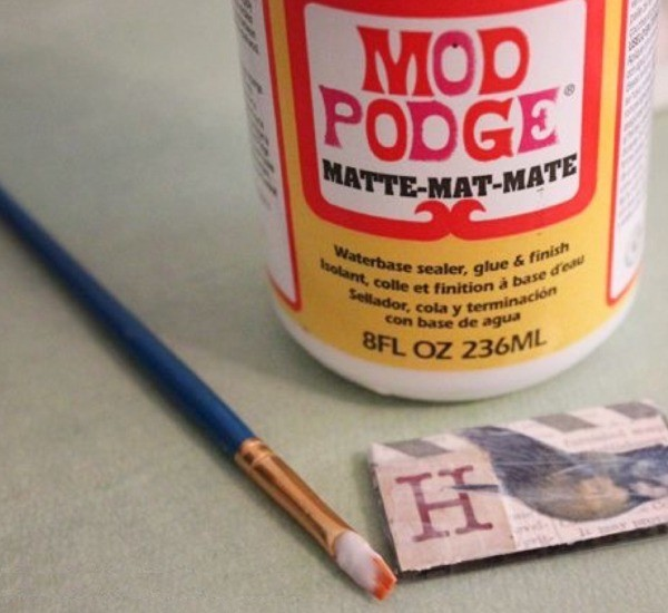 A bottle of Mod Podge and a paintbrush.
