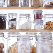 Clear glass jars inside of a pantry.