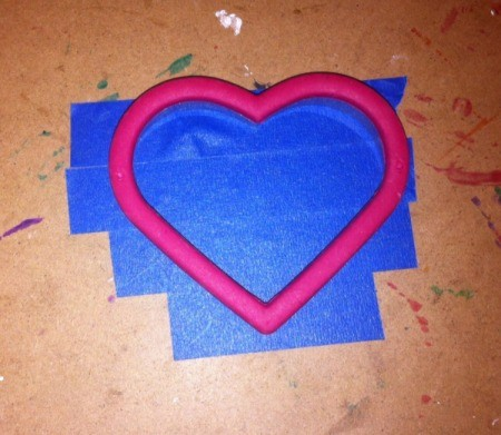 Love and Arrow Finger Paintings - use cookie cutter to trace heart shape on tape, cut out