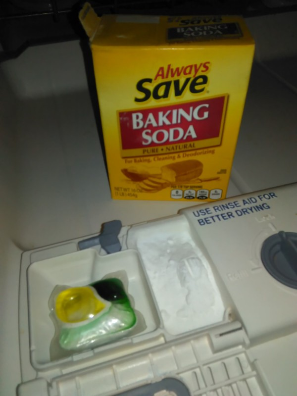 Use Baking Soda in the Dishwasher - dishwasher dispenser and box of baking soda