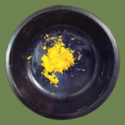 Uses For Orange Zest - small dark bowl with orange zest in bottom