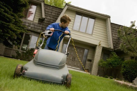 12 year old mowing a lawn.