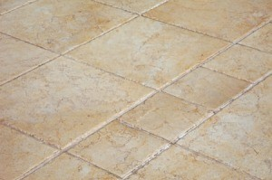 A tan colored ceramic tile floor.
