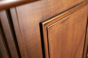The corner of a wood cabinet door.