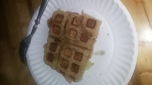 Peanut Butter and Banana Sandwich Waffle on paper plate