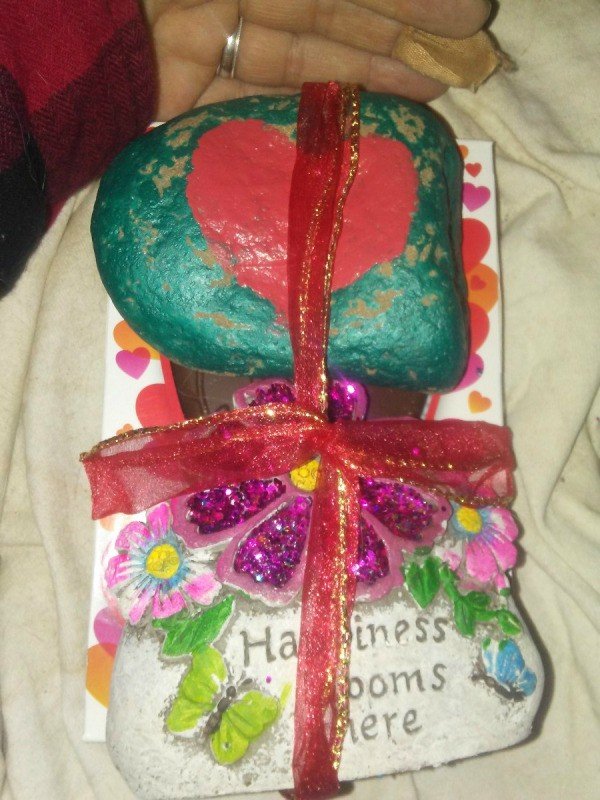A Valentine's day gift with a painted rock and other treats.