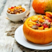 A pumpkin stuffed with a meat and vegetable stew.
