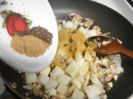 Adding spices to pan