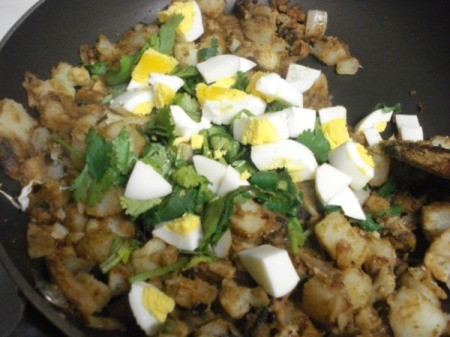 Adding chopped egg and cilantro to pan