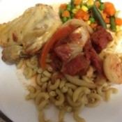chicken Paprikas on plate with macaroni and mixed vegetables