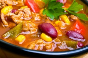 A country stew with tomatoes, kidney beans and corn.