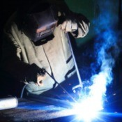 A person welding.